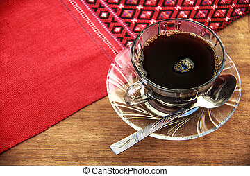 black coffee on wooden table with handmade red tablecloth...