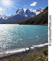 A strong wind blows turquoise waves on the lake, grand...