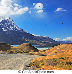 Snow-capped peaks - Snow-capped mountain peaks, the lake and...