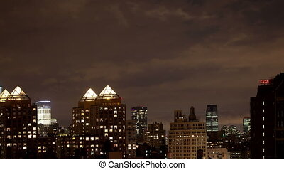 timelapse of manhattan skyline from a high vantage point at night