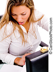 top view of surprised businesswoman looking at document in...