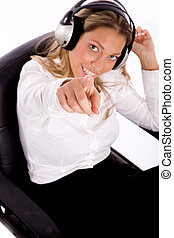 top view of businesswoman listening music against white...