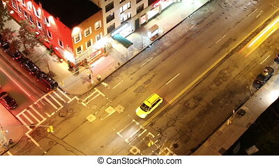 time-lapse looking down onto a new york street of fast...