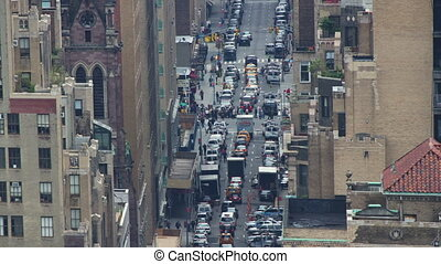 extreme zoomed timelapse of manhattan street scene from a high vantage point