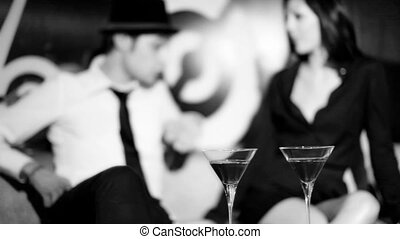 A young couple having fun together in a cool looking club...