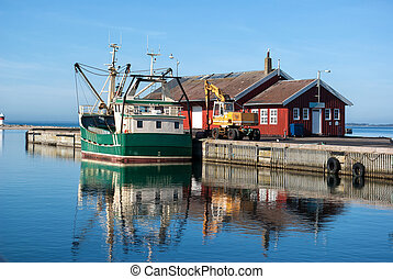 Fishing trawler docking in a Danish commercial harbor