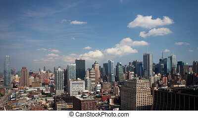 panning timelapse of midtown manhattan skyline from a high vantage point on a beautiful clear day