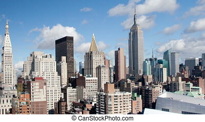 timelapse of midtown manhattan skyline from a high vantage point on a beautiful day