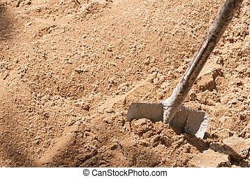 Shovel on the sand closeup