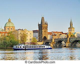 Charles Bridge of Prague with a boat on river Vltava
