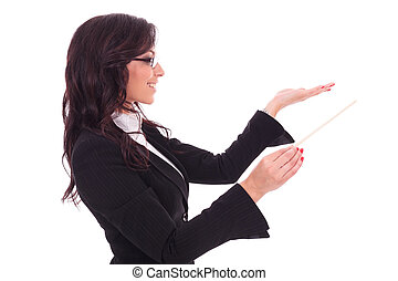 business woman conducting - side view of a young business...