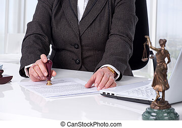 Signing contract - Notary public signing document at his...