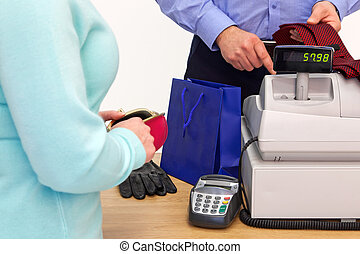 Woman buying gifts for a man - A woman at the store checkout...