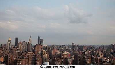 panning timelapse of midtown manhattan skyline from a high...