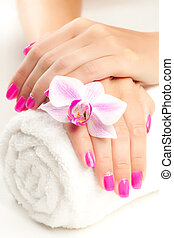 beautiful pink manicure with pink orchid and towel - female...