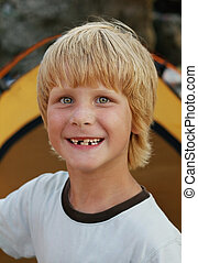 portrait of young smiling boy - close up portrait of happy...