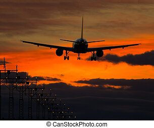 Airplane - Big jet plane landing on runway in evening