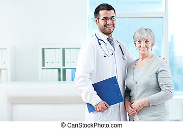 Doctor and patient - Senior patient and successful doctor...