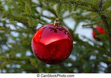 Christmas ball - christmas red ball on green new year tree