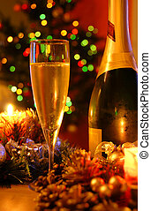 New year champagne - glass of champagne and bottle over new...