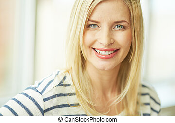 Charming blonde - Portrait of pretty woman looking at camera...
