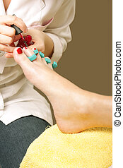 Feet care - Woman feet cared by pedicurist over brown...