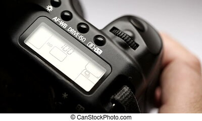 DSLR Camera - Adjusting a DSLR camera and shooting