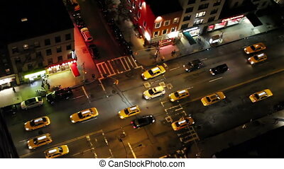 looking down onto a new york street of fast moving traffic...