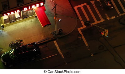 looking down onto a sidewalk in new york at night
