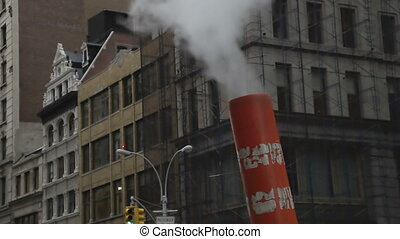smoke comes out of a chimney from the nyc subway, new york