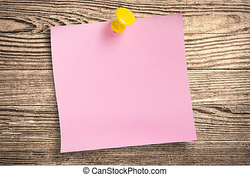 Pink paper note on wood, clipping path. - Pink paper note...