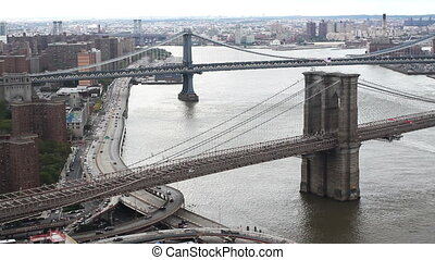 lower manhattan skyline and brooklyn bridge from a high...