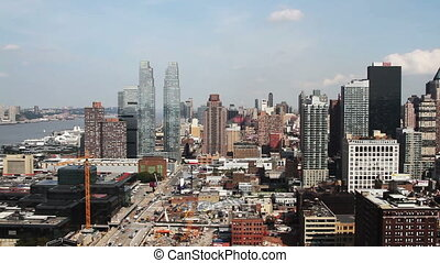 panning video of midtown manhattan skyline shot from a high...