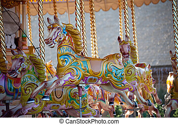 Carousel horses - Colorful wooden horses on a carousel ride