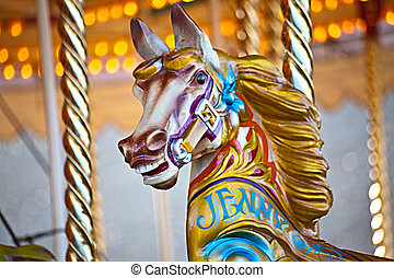 Carousel horse - A colorful wooden horse on a carousel ride