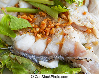Fish poached in white dish. - Fish poached in white dish...
