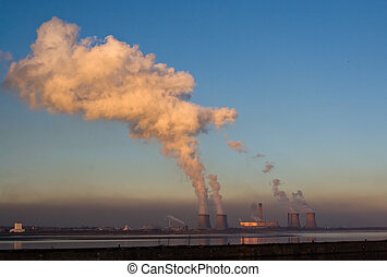 Power station - A power station at dusk reflected in the...