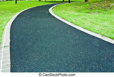 Winding Path through a Peaceful Green Garden