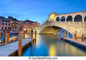 Rialto bridge at night in Venice