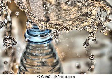 Water bottle, with water droplets flying about
