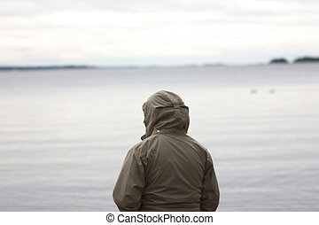 A person looking towards the sea