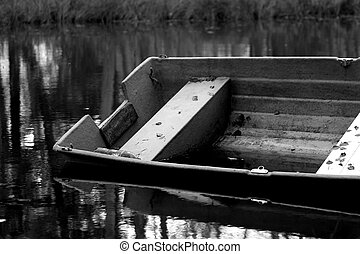 Sinking boat, left behind in a dark river