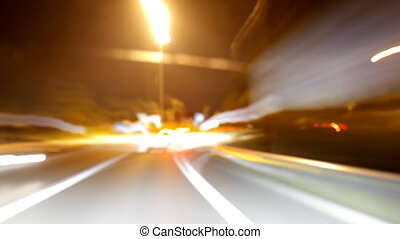 Long exposed nightime timelapse shot from a moving car with...