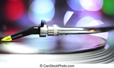 close-up of the needle of dj record player, with abstract...