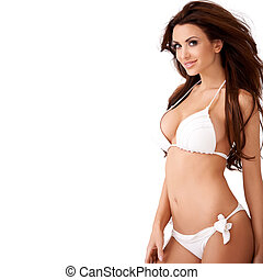 Smiling sexy young brunette in a bikini - Smiling sexy young...