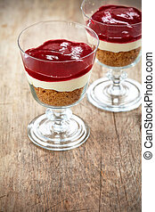 Dessert with cream and cranberry sauce - two glasses of...