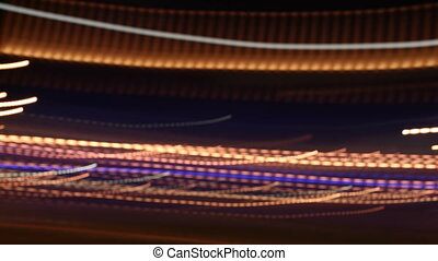pattern made from traffic rushing by at night with a long exposure to create light trails