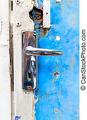 Latch - The old rusty latch of the home door.