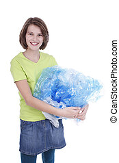 Girl carries plastic waste - Girl recycles plastic waste