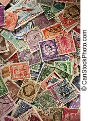 Colorful Vintage Used Postage Stamps in a pile